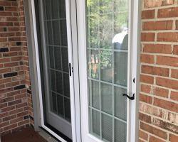 New door with blinds between the glass