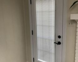 How about blinds between the glass in your new door!