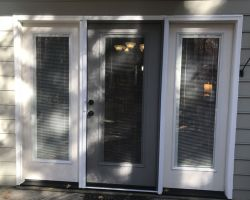 A three section patio doo with mini blinds between the insulated glass, retractable screen